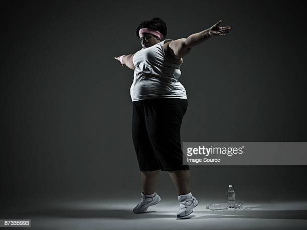 Overweight woman exercising