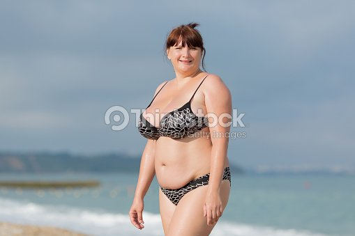 overweight young woman at the sea stock photo thinkstock. Black Bedroom Furniture Sets. Home Design Ideas