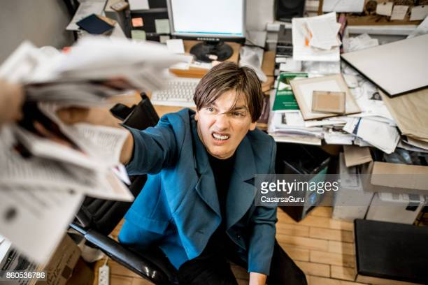 Overworked Angry Businessman Throwing Paper All Over The Office