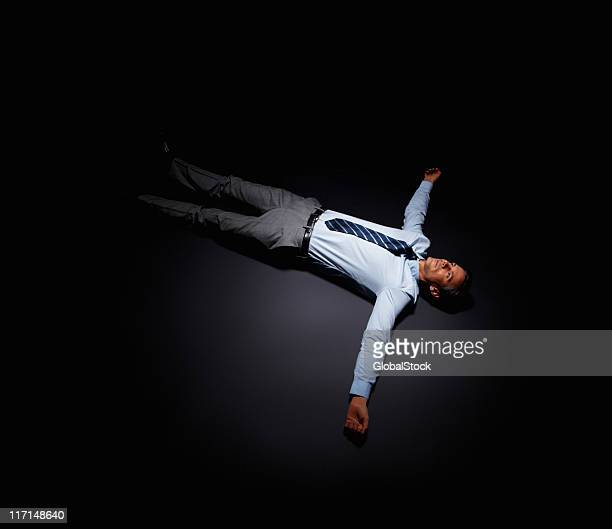 Overworked businessman lying down