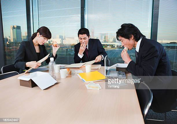 Overworked Japanese Office Workers Working Through Lunch