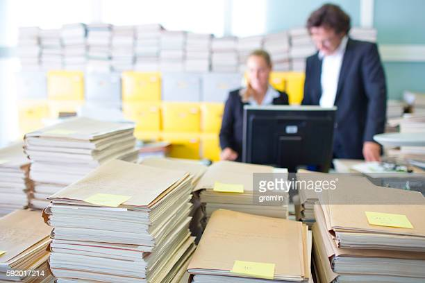 Overworked office workers, bureaucracy, archives