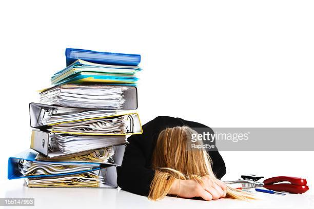 Overworked young businesswoman collapses at her desk