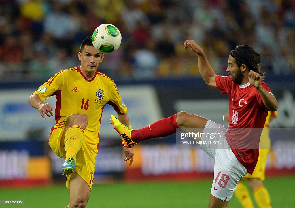 Ovidiu Hoban (L) of Romania vies for the ball with Olkay Sahan (R) of Turkey during the FIFA World Cup 2014 qualifying football match Romania vs Turkey in Bucharest on September 10, 2013. AFP PHOTO / DANIEL MIHAILESCU
