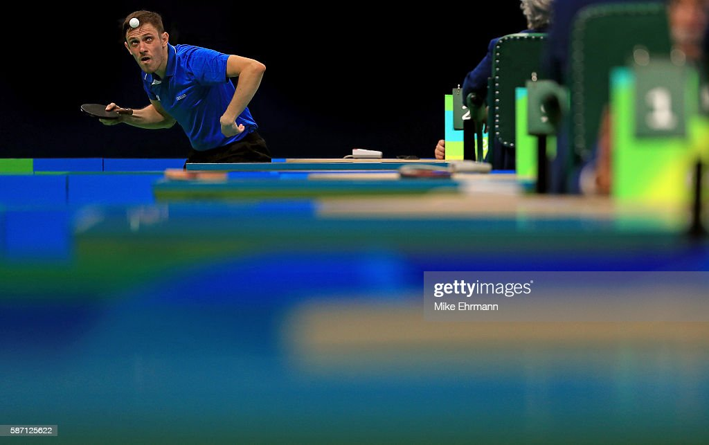 Ovidiu Ionescu of Romania plays a Men's Singles second round match against Robert Gardos of Austria on Day 2 of the Rio 2016 Olympic Games at Riocentro - Pavilion 3 on August 7, 2016 in Rio de Janeiro, Brazil.