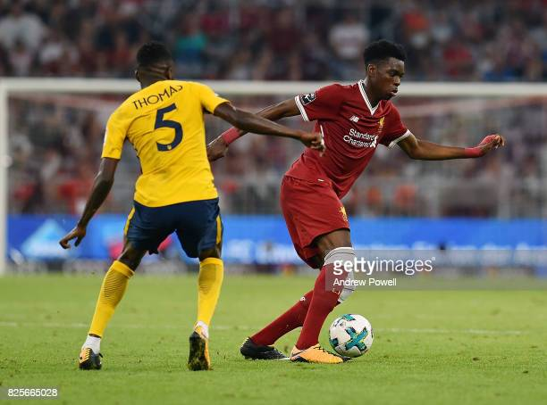 Ovie Ejaria of Liveprool competes with Thomas Partey of Atletico Madrid during the Audi Cup 2017 match between Liverpool FC and Atletico Madrid at...