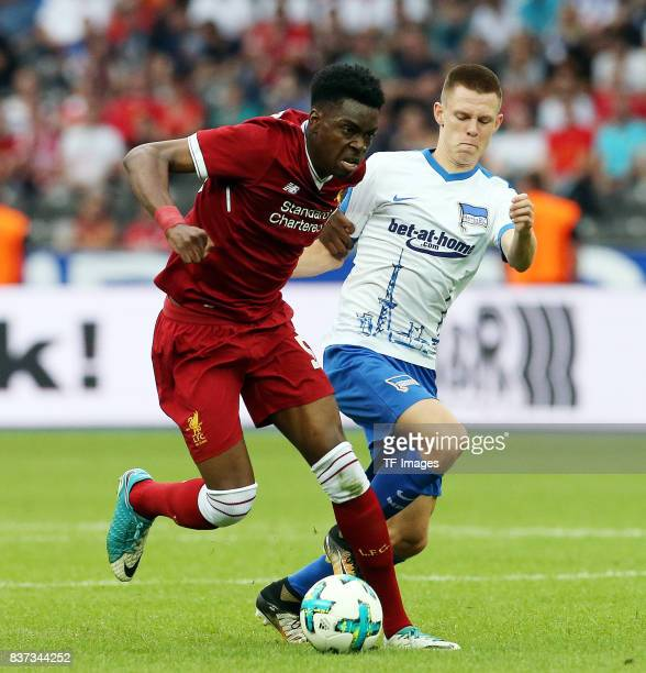 Ovie Ejaria of Liverpool and Julius Kade of Hertha controls the ball during the Preseason Friendly match between Hertha BSC and FC Liverpool at...