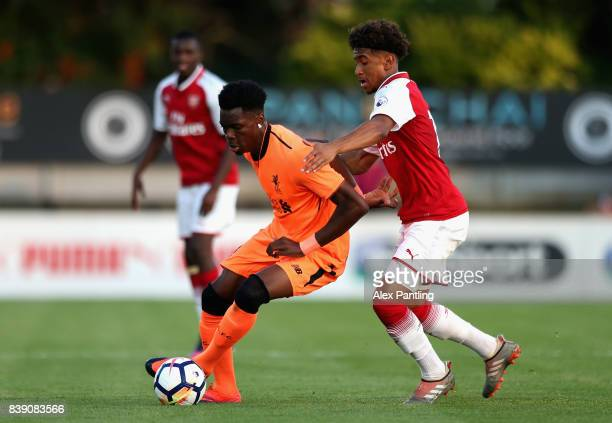 Ovie Ejaria of Liverpool and Reiss Nelson of Arsenal in action during the Premier League 2 match between Arsenal and Liverpool at Meadow Park on...