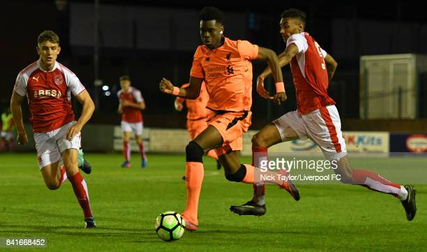 Ovie Ejaria of Liverpool and Victor Nirennold of Fleetwood Town in action during the Molson Coors Senior Cup Final at The County Ground on September...