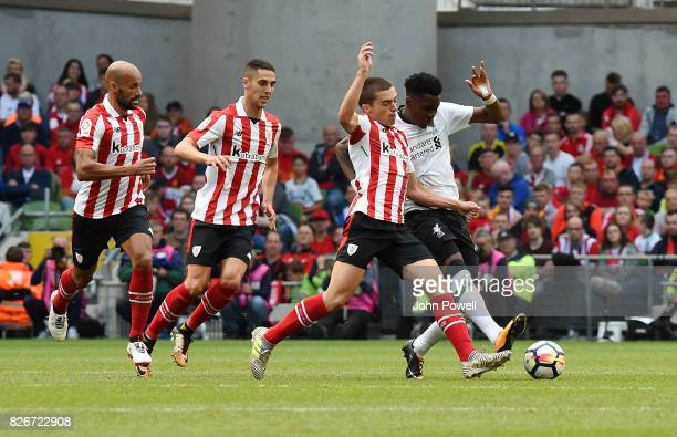 Ovie Ejaria of Liverpool competes with Inigo Cordoba of Athletic Bilbao during a pre season friendly match between Liverpool and Athletic Bilbao at...