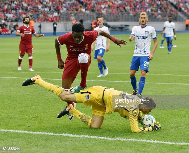 Ovie Ejaria of Liverpool competes with Rune Jarstein of Hertha BSC during the preseason friendly match between Hertha BSC and FC Liverpool at...