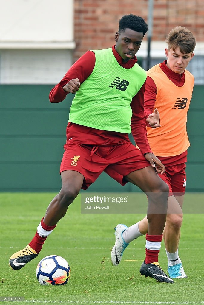 Ovie Ejaria with Ben Woodburn of Liverpool during a training session at Melwood Training Ground on August 10, 2017 in Liverpool, England.