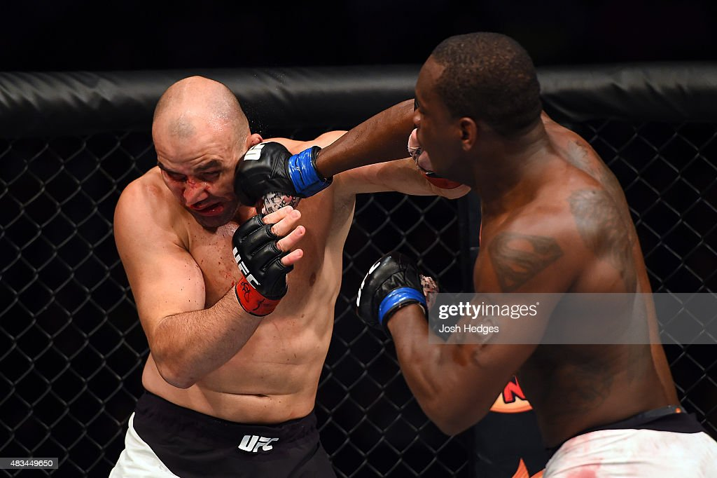 Ovince Saint Preux punches Glover Teixeira of Brazil in their light heavyweight bout during the UFC Fight Night event at Bridgestone Arena on August 8, 2015 in Nashville, Tennessee.