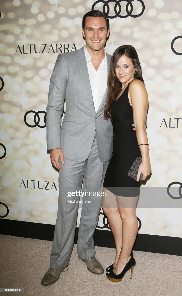 Owain Yeoman and wife, Gigi Yallouz arrive at the Audi and Altuzarra EMMYs week 2013 kick-off party held at Cecconi's Restaurant on September 15, 2013 in Los Angeles, California.