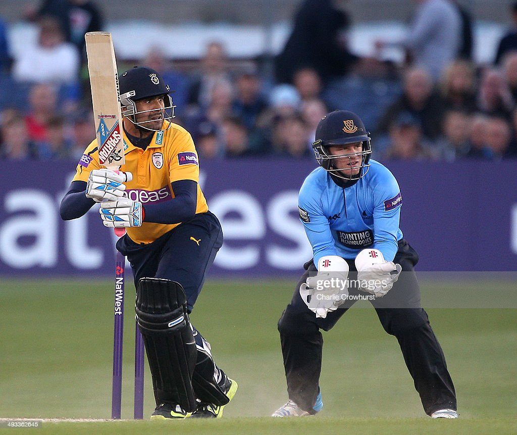 Owais Shah of Hampshire hits out while Ben Brown of Sussex looks on during the Natwest T20 Blast match between Sussex Sharks and Hampshire at The...