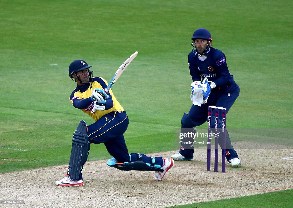 Owais Shah of Hampshire hits out while Essex's James Foster looks on during the Natwest T20 Blast match between Hampshire and Essex at The Rose Bowl...