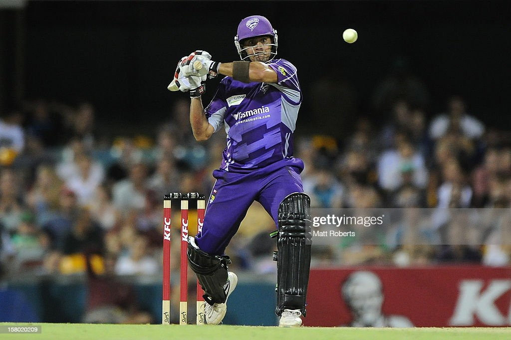 <a gi-track='captionPersonalityLinkClicked' href=/galleries/search?phrase=Owais+Shah&family=editorial&specificpeople=227194 ng-click='$event.stopPropagation()'>Owais Shah</a> of the Hurricanes bats during the Big Bash League match between the Brisbane Heat and the Hobart Hurricanes at The Gabba on December 9, 2012 in Brisbane, Australia.