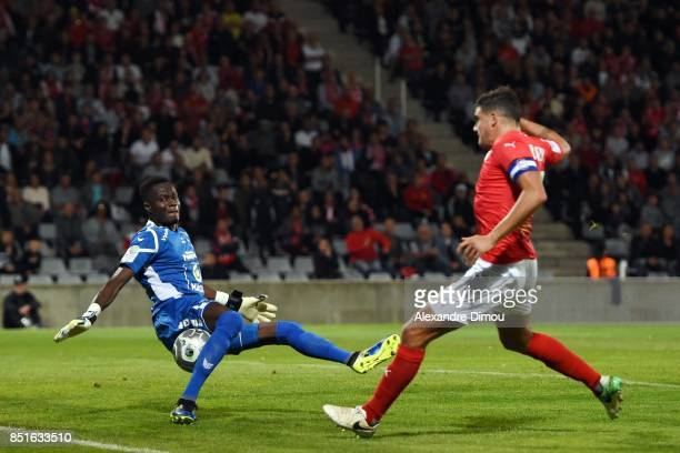 Owalabi Allagbe of Niort and Anthony Briancon of Nimes during the French Ligue 2 mach between Nimes and Niort at on September 22 2017 in Nimes France