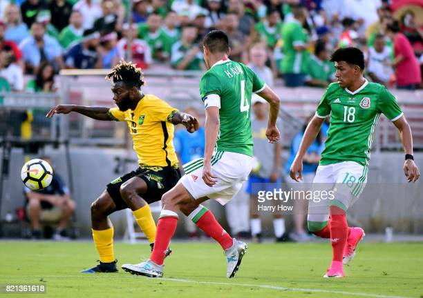 Owayne Gordon of Jamaica gets away from Hugo Ayala and Jesus Gallardo of Mexico during a 10 Jamaican win in the CONCACAF 2017 semifinal at Rose Bowl...