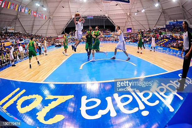 Owen Classen of Canada and Cristiano Felicio of Brazil during the Men's Basketball match between Brazil and Canada in the 2011 XVI Pan American Games...