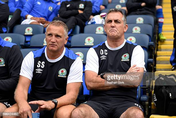 Owen Coyle manager of Blackburn Rovers and Sandy Stewart the assistant look on during the Sky Bet Championship match between Blackburn Rovers and...