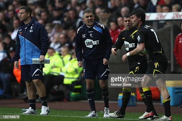 Owen Coyle manager of Bolton shouts towards Paul Robinson and Chris Eagles during the Barclays Premier League match between Swansea City and Bolton...