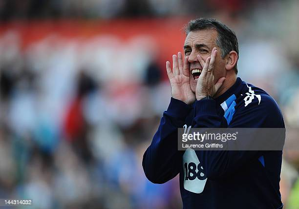 Owen Coyle manager of Bolton Wanderers gives instructions during the Barclays Premier League match between Stoke City and Bolton Wanderers at...