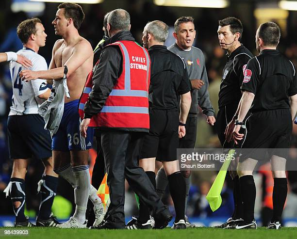 Owen Coyle manager of Bolton Wanderers talks to the officials after the Barclays Premier League match between Chelsea and Bolton Wanderers at...