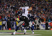 Owen Daniels of the Baltimore Ravens catches a touchdown pass during the second quarter of the 2015 AFC Divisional Playoffs game against the New...