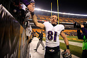Owen Daniels of the Baltimore Ravens celebrates with fans after defeating the Pittsburgh Steelers 3017 in their AFC Wild Card game at Heinz Field on...