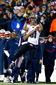 Owen Daniels of the Baltimore Ravens goes up for a pass against Patrick Chung of the New England Patriots in the first half during the 2014 AFC...