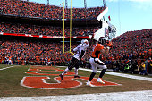 Owen Daniels of the Denver Broncos catches a 12yard touchdown pass in the second quarter against Jamie Collins of the New England Patriots in the AFC...