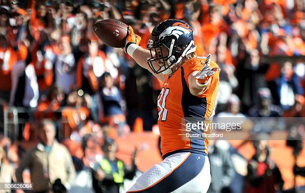 Owen Daniels of the Denver Broncos celebrates after scoring a 21yard first quarter touchdown against the New England Patriots in the AFC Championship...