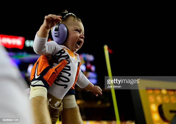 Owen Daniels of the Denver Broncos lifts his baby up at the end of the game The Denver Broncos played the Carolina Panthers in Super Bowl 50 at...