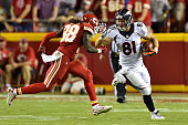 Owen Daniels of the Denver Broncos stiff arms Ron Parker of the Kansas City Chiefs during the game at Arrowhead Stadium on September 17 2015 in...