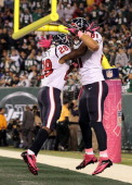 Owen Daniels of the Houston Texans celebrates his touchdown against the New York Jets with teammate Justin Forsett at MetLife Stadium on October 8...