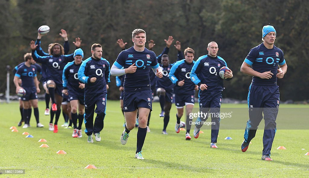 <a gi-track='captionPersonalityLinkClicked' href=/galleries/search?phrase=Owen+Farrell&family=editorial&specificpeople=4809668 ng-click='$event.stopPropagation()'>Owen Farrell</a> and <a gi-track='captionPersonalityLinkClicked' href=/galleries/search?phrase=Billy+Twelvetrees&family=editorial&specificpeople=6175351 ng-click='$event.stopPropagation()'>Billy Twelvetrees</a> lead the lines during the England training session held at Pennyhill Park on October 29, 2013 in Bagshot, England.