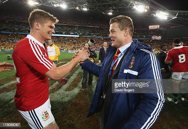 Owen Farrell and Brian O'Driscoll of the Lions celebrate after their victory during the International Test match between the Australian Wallabies and...