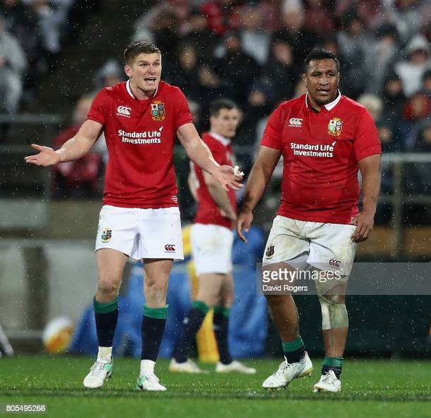 Owen Farrell and Mako Vunipola of the Lions appeal to referee Jerome Garces during the match between the New Zealand All Blacks and the British Irish...