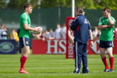 Owen Farrell and Stuart Hogg talk with coach Rob Howley during the British and Irish Lions media session held at Carton House on May 21 2013 in...