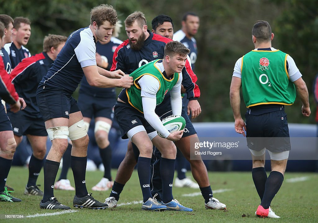 <a gi-track='captionPersonalityLinkClicked' href=/galleries/search?phrase=Owen+Farrell&family=editorial&specificpeople=4809668 ng-click='$event.stopPropagation()'>Owen Farrell</a> holds onto the ball during the England training session at Pennyhill Park on February 5, 2013 in Bagshot, England.