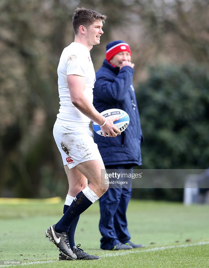 <a gi-track='captionPersonalityLinkClicked' href=/galleries/search?phrase=Owen+Farrell&family=editorial&specificpeople=4809668 ng-click='$event.stopPropagation()'>Owen Farrell</a> looks on watched by head coach <a gi-track='captionPersonalityLinkClicked' href=/galleries/search?phrase=Eddie+Jones+-+Rugby+Coach&family=editorial&specificpeople=13966519 ng-click='$event.stopPropagation()'>Eddie Jones</a> during the England training session held at Pennyhill Park on February 12, 2016 in Bagshot, England.