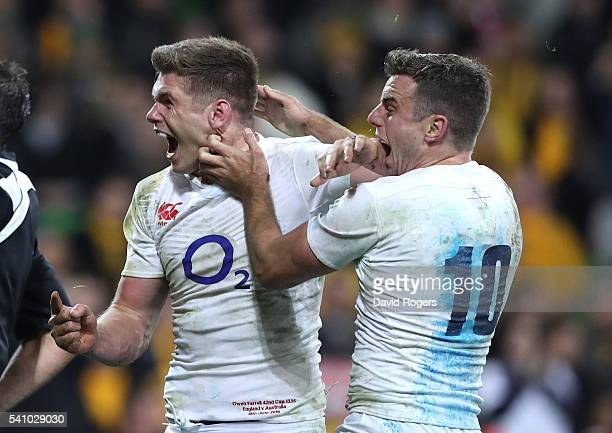 Owen Farrell of England celebrates with team mate George Ford after scoring the winning try during the International Test match between the...
