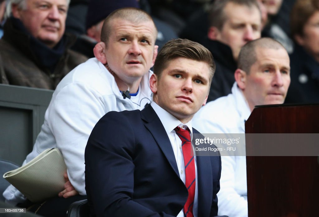 Owen Farrell of England, Graham Rowntree, forwards coach of England and Stuart Lancaster head coach of England look on from the bench during the RBS Six Nations match England and Italy at Twickenham Stadium on March 10, 2013 in London, England.