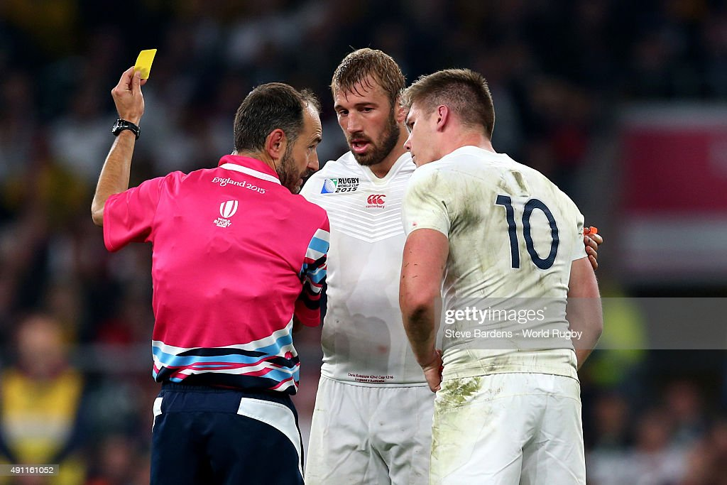 Owen Farrell of England is shown a yellow card by referee Romain Poite as Chris Robshaw of England looks on during the 2015 Rugby World Cup Pool A...