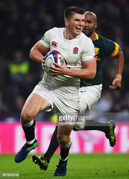 Owen Farrell of England runs with the ball to score his team's fourth try during the Old Mutual Wealth Series match between England and South Africa...