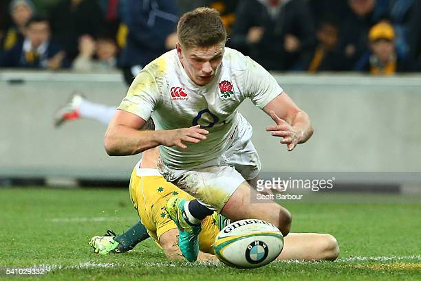 Owen Farrell of England scores the winning try during the International Test match between the Australian Wallabies and England at AAMI Park on June...