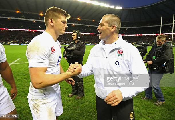 Owen Farrell of England shakes hands with Head Coach Stuart Lancaster of England during the QBE International match between England and New Zealand...