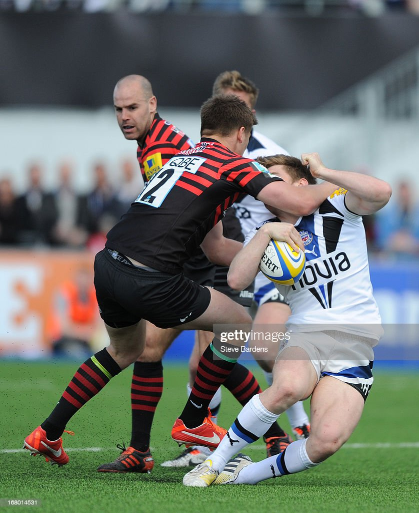 <a gi-track='captionPersonalityLinkClicked' href=/galleries/search?phrase=Owen+Farrell&family=editorial&specificpeople=4809668 ng-click='$event.stopPropagation()'>Owen Farrell</a> of Saracens catches Tom Heathcote of Bath with a high tackle during the Aviva Premiership match between Saracens and Bath at Allianz Park on May 04, 2013 in Barnet, England.