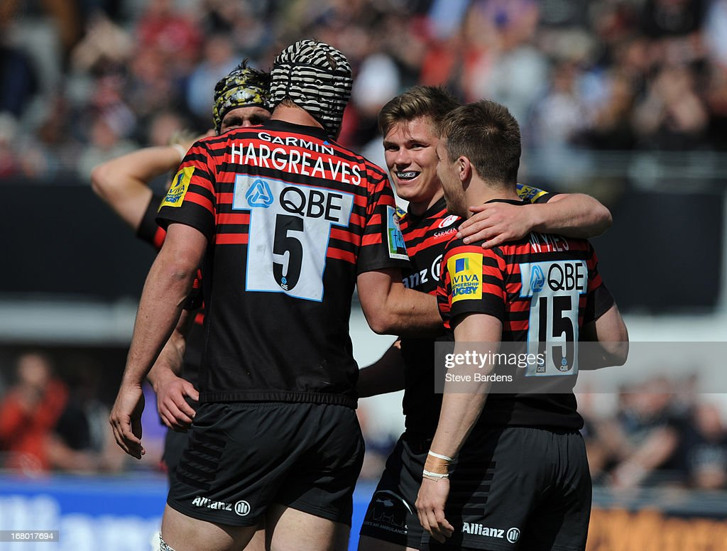 Owen Farrell of Saracens celebrates scoring a try with his team-mates during the Aviva Premiership match between Saracens and Bath at Allianz Park on May 04, 2013 in Barnet, England.